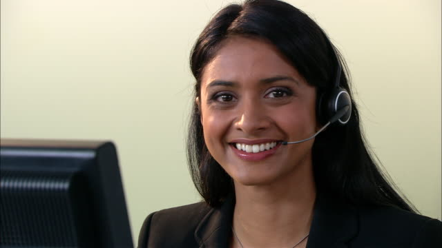 CU, Female customer service representative at work, portrait