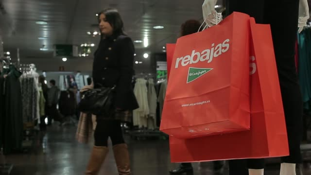 Female customers browse women's clothes department inside the El Cortes Ingles department store on the first day of sales in Madrid Spain on Tuesday...