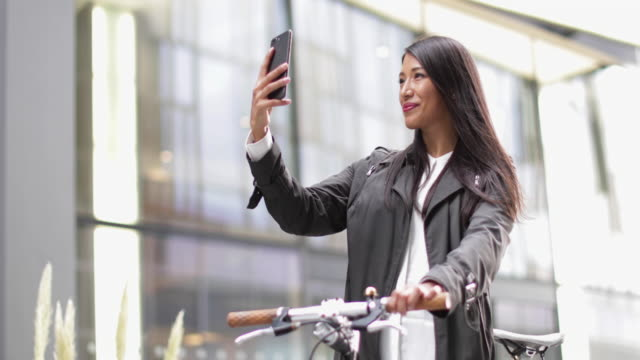 Female cyclist taking a selfie