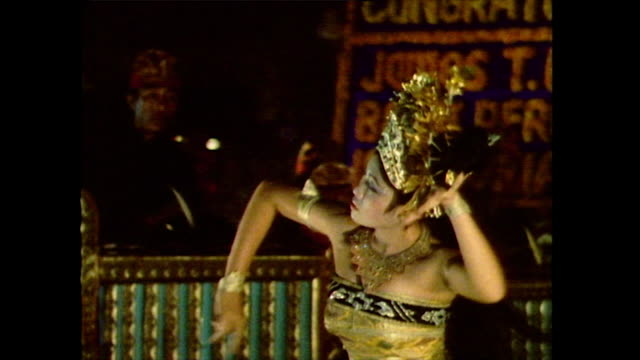 a female dancer in bali performs the traditional 'oleg' dance known as the 'dance of the bumblebees' for tourists in 1985 - pacific islander stock videos & royalty-free footage