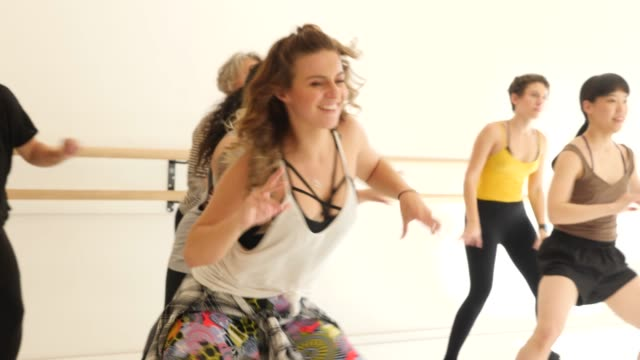 female dancer teaching students in dance class - aerobics stock videos & royalty-free footage