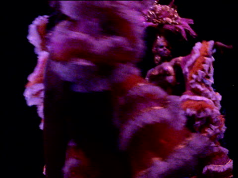 female dancers in latin american cabaret strut past camera wearing outrageous showgirl costumes made up of bikinis frills and headdresses cuba\n - showgirl stock videos and b-roll footage