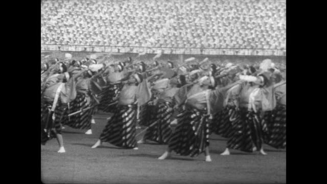 2000 female dancers in traditional clothing perform at tokyo national stadium during buddhist religious festival / dance using ladders / crowd... - symbols of peace stock videos & royalty-free footage
