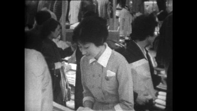 female department store staff bow to customers; 1958 - department store stock videos & royalty-free footage