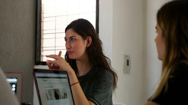 ms female designer discussing project with client in design studio - long hair stock videos & royalty-free footage