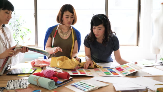 Female designer team having discussion about materials