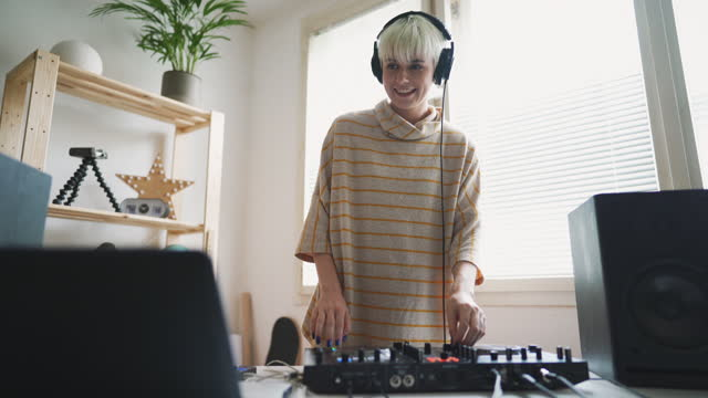 female dj streaming live music from a home music studio - stream stock videos & royalty-free footage