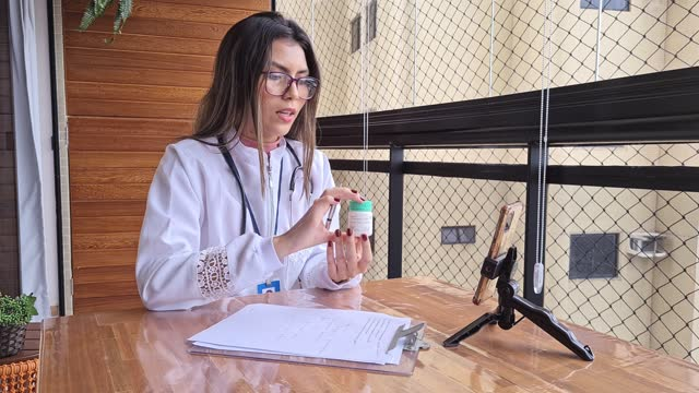 female doctor attending to an online appointment from home - pardo brazilian stock videos & royalty-free footage