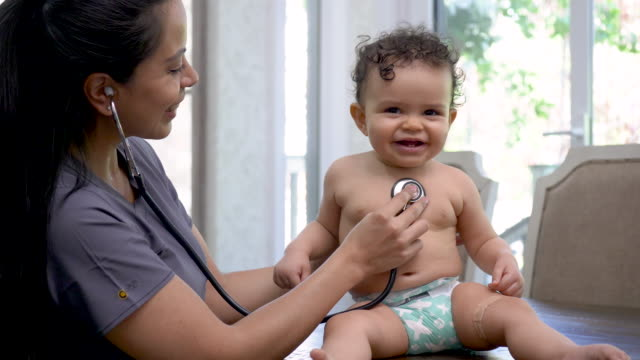 female doctor check's baby's heart rate - pediatrician stock videos & royalty-free footage