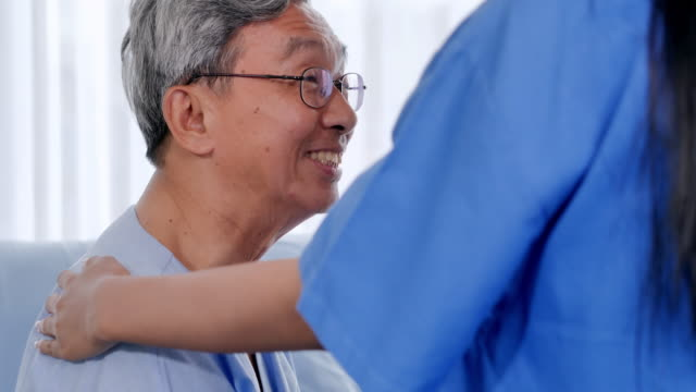 female doctor comforting patient senior man at consulting room.caring medical worker in hospital talking to elderly man at hospital.medical, age, health care, cardiology and people concept.healthcare: caretaking.doctor and patient consultation. - body care stock videos & royalty-free footage