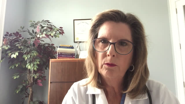 female doctor converses with patient via video call - female doctor stock videos & royalty-free footage