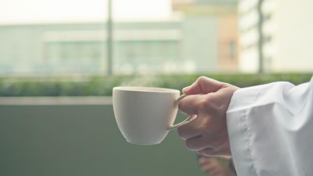 female doctor drinking hot coffee - coffee break stock videos & royalty-free footage