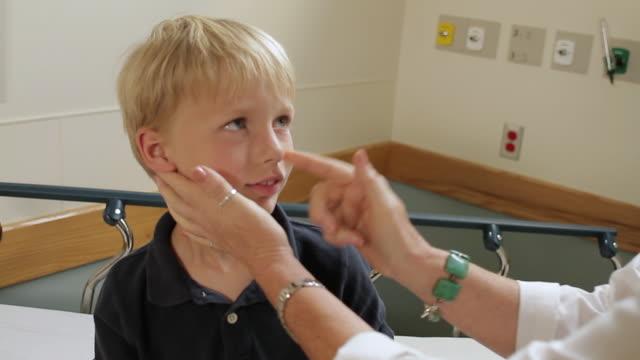 cu zo ms female doctor examining boy (8-9) in hospital room / portland, maine, usa - boy medical exam stock videos and b-roll footage