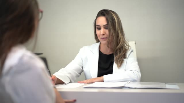 female doctor giving a prescription medicine - clinica medica video stock e b–roll