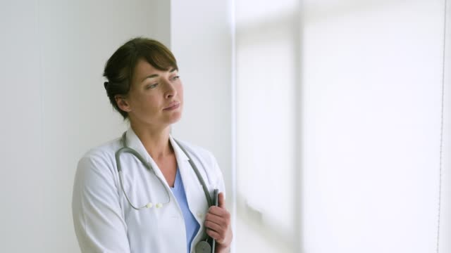 female doctor in office working with digital tablet. - dottoressa video stock e b–roll