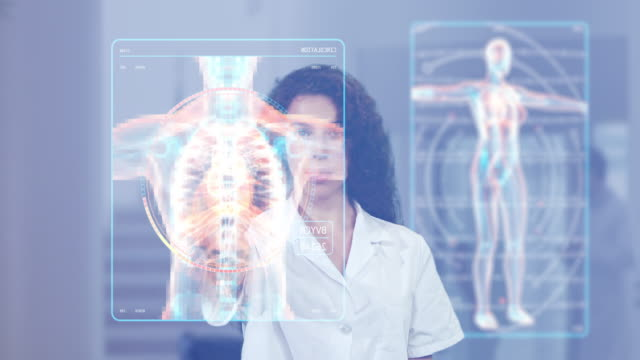 female doctor looking at futuristic medical charts at a high tech hospital - cyberspace stock videos & royalty-free footage