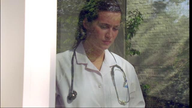 MS, PAN, DS., ZI, female doctor looking through window glass, Brussels, Belgium