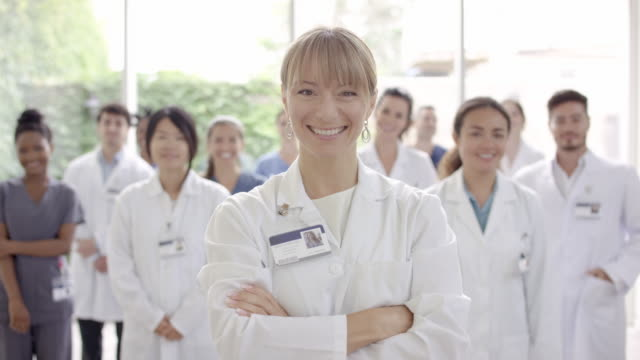 female doctor smiling into camera - laboratory coat stock videos & royalty-free footage