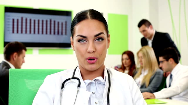 Female Doctor Talking At The Camera