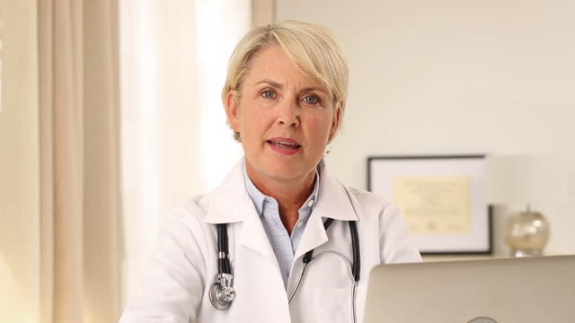 Female Doctor talking into camera
