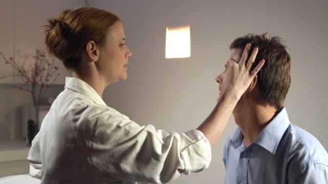 CU, Female doctor talking to male patient in office, Sydney, Australia