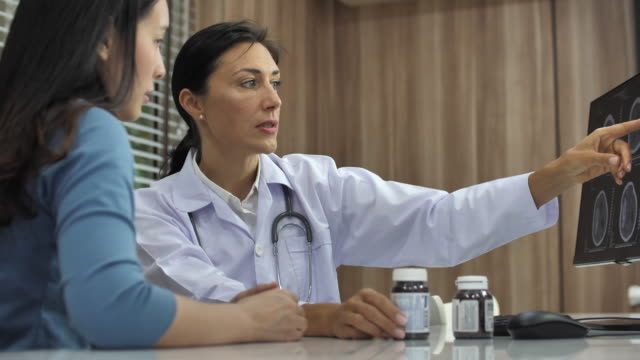 female doctor talking with patient - general practitioner stock videos & royalty-free footage