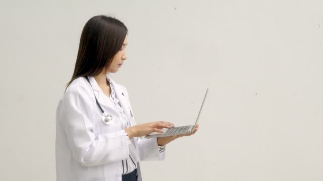 female doctor use laptop - only mature women stock videos & royalty-free footage