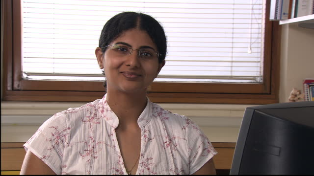 CU, Female doctor using computer in office, portrait