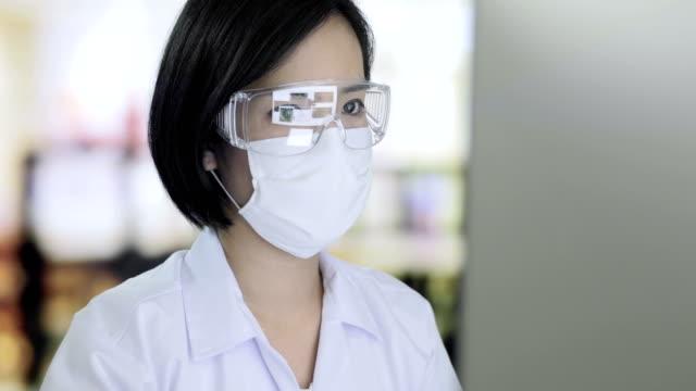 Female Doctor using desktop computer