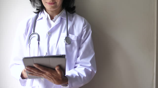 female doctor using digital tablet for diagnose symptoms - medical occupation stock videos and b-roll footage