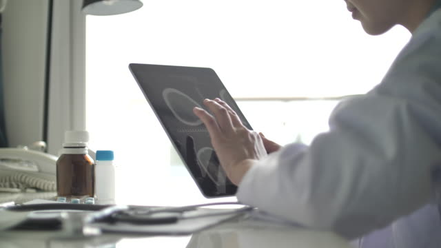 female doctor using digital tablet in her office - medical clinic stock videos & royalty-free footage