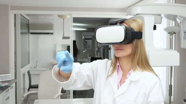 Female doctor using virtual reality headset