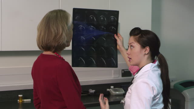 female doctor using x-ray and discussing with patient - greater london stock videos and b-roll footage