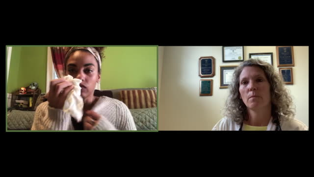 female doctor video chats with a sick patient. - video stock videos & royalty-free footage