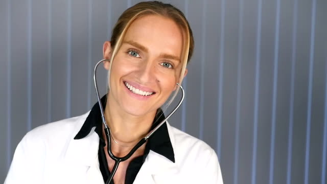 Female doctor with stethoscope in ears