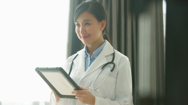 MS female doctor working on a digital tablet