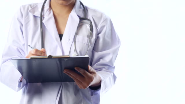 Female Doctor Writing Report on Clipboard