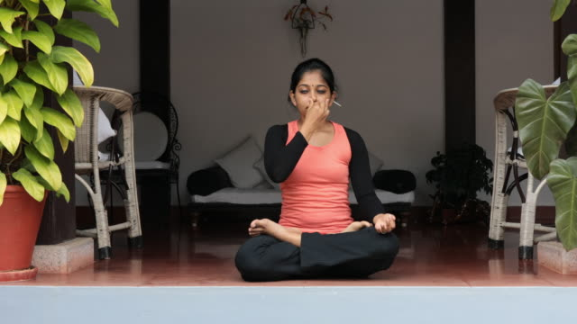 female doing pranayama - inhaling stock videos & royalty-free footage