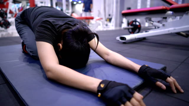 female doing yoga stretching at gym. - 30 39 years stock videos & royalty-free footage