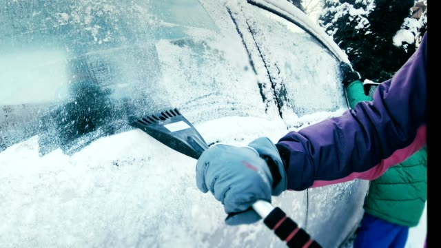 female driver scraping snow covered car windows - scraping stock videos and b-roll footage