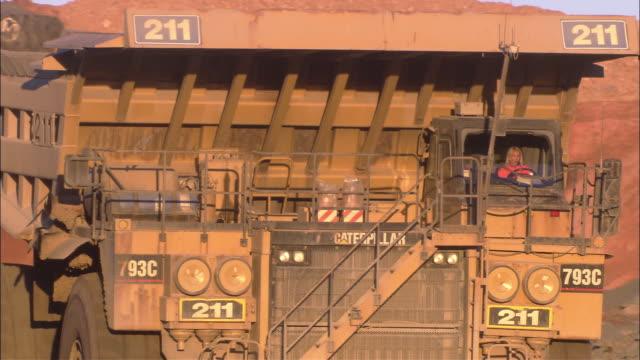 ms pan female driving dump truck, kcgm gold mine, kalgoorlie, western australia, australia - gold mine stock videos and b-roll footage