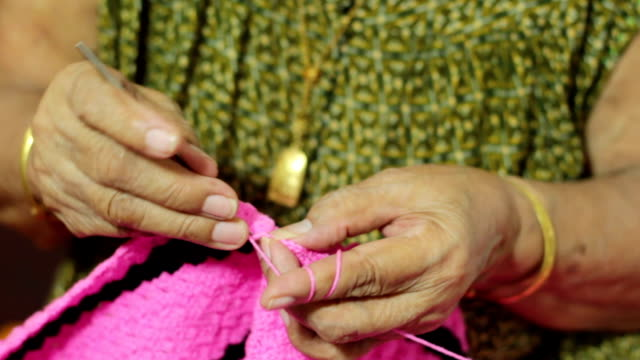 female elder knitting a blanket - duvet stock videos & royalty-free footage