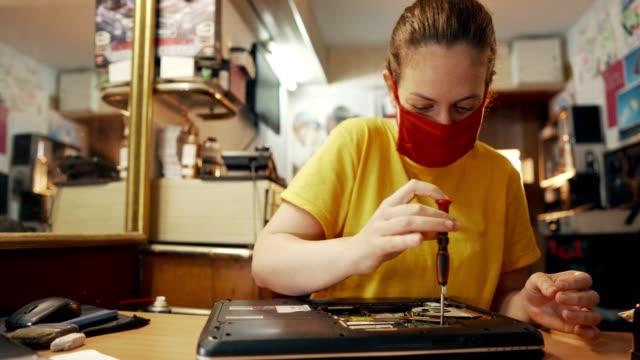 female electronic engineer in workshop - engineer stock videos & royalty-free footage