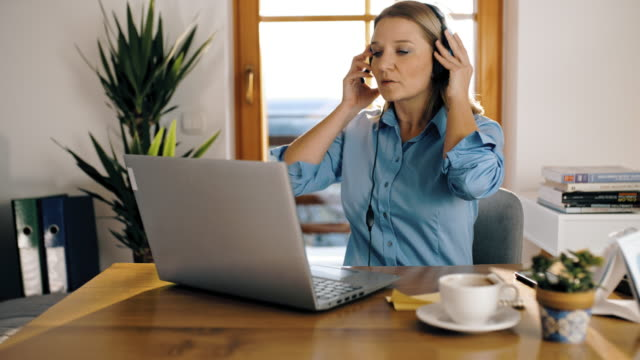 ds female employee from a call centre working from home - headset stock videos & royalty-free footage