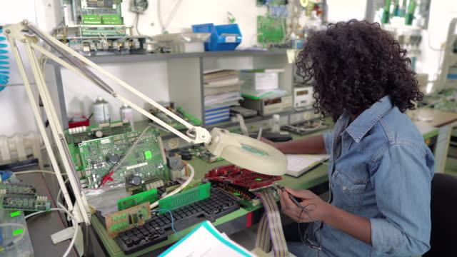 female engineer at work - electronics industry stock videos & royalty-free footage