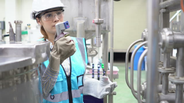 female engineer at work - manufacturing occupation stock videos and b-roll footage