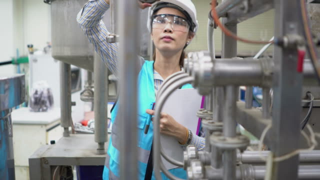 female engineer at work - manufacturing occupation stock videos & royalty-free footage