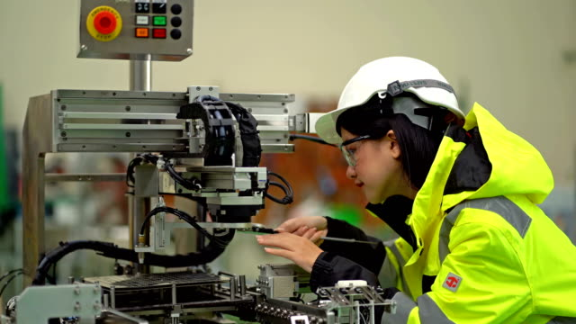 female engineer build robotic machinery technological - machine part stock videos & royalty-free footage