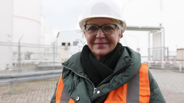 female engineer in protective workwear at refinery - females stock videos & royalty-free footage