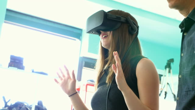 r/f female engineer testing program on virtual reality headset in computer lab - cyberspace stock videos & royalty-free footage